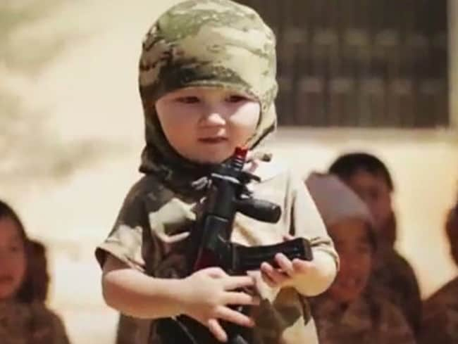 The video shows one very young child holding a gun.