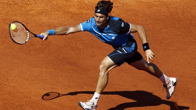David Ferrer lunges for the ball during his Portugal Open semi against Andreas Seppi in Oeiras. Ferrer won 6-1, 6-4. Picture: Francisco Seco
