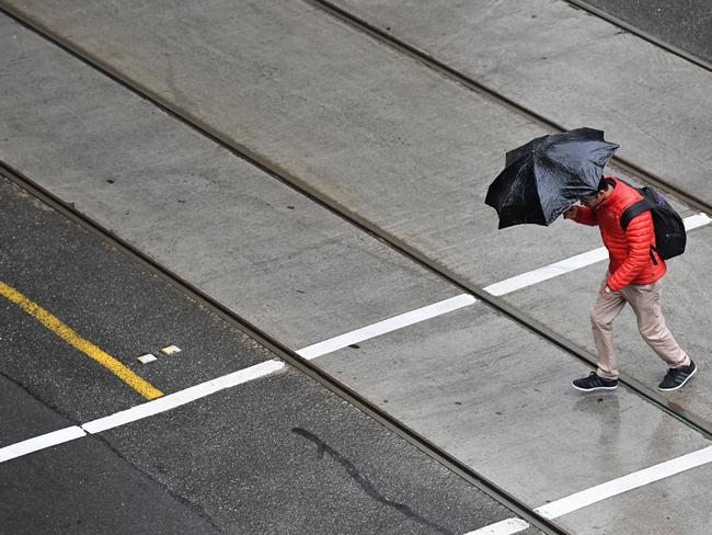 Bourke Street in Melbourne's CBD as the rain struck on Saturday. Picture: AAP Image/James Ross.