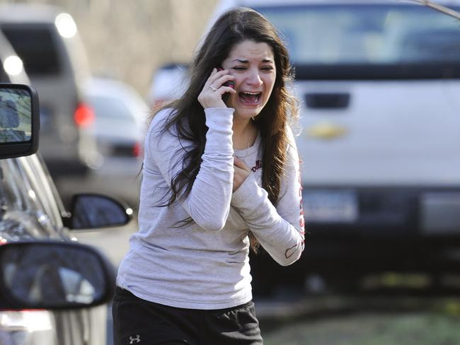 Carlee Soto uses a phone to get information about her sister, Vicki Soto, a teacher at the Sandy Hook elementary school in Newtown on Friday, December 14, 2012. Picture: Jessica Hill/AP
