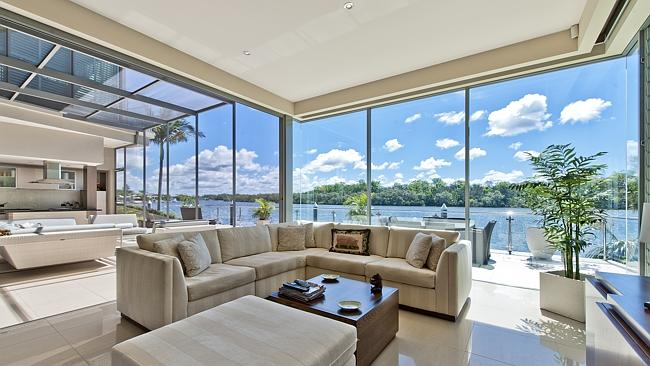 WATERFRONT MANSION: The kids will love the pool, games room and home theatre. Dad will love parking the boat out the front and the wine cellar in this six bedroom Sanctuary Cove home.