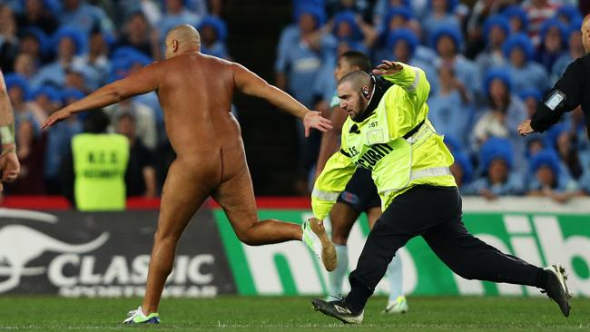 Wati Holmwood does his naked dash across the field during the Satte of Origin decider. Picture: Brett Costello