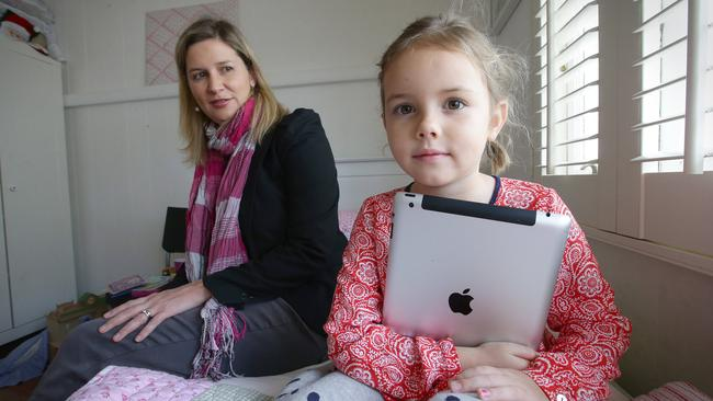 Caroline Thorne, with daughter Claudio, only has child-friendly apps but is concerned about the apps like Star Girl which appear child-friendly.