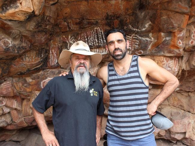 Going back ... Adam Goodes with Cliff Coulthard at the Malkawi cave painting site in The Flinders Rangers in South Australia. Picture: SBS