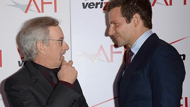 Spielberg talks shop with Bradley Cooper on the red carpet. Wonder what influential things he's saying.