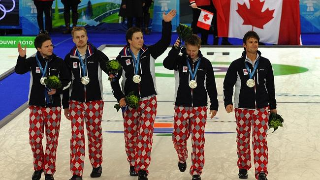 Norway's silver medallists celebrate after the medals ceremony in Vancouver.