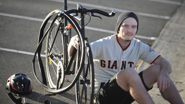 Ryan Kitching, 34, with his mangled bike after he was knocked down