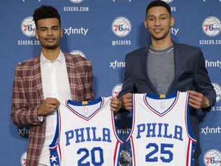 Philadelphia 76ers NBA basketball draft picks Timothe Luwawu-Cabarrot, left, and Ben Simmons pose for photographs during a news conference in Philadelphia, Friday, June 24, 2016. (AP Photo/Matt Rourke)