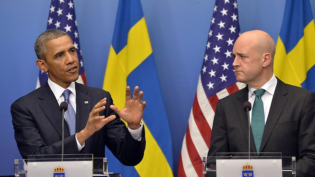 US President Barack Obama (L) answers a question on Syria during a joint press conference with Swedish Prime Minister Fredrik Reinfeldt following their bilateral meeting at the Rosenbad Building in Stockholm on September 4, 2013. Obama met with Fredrik Reinfeldt upon arrival in Sweden on a two-day official trip before leaving for Russia, where he will attend G20 summit. Russia on Thursday hosts the G20 summit hoping to push forward an agenda to stimulate growth but with world leaders distracted by divisions on the prospect of US-led military action in Syria. AFP PHOTO / JEWEL SAMAD