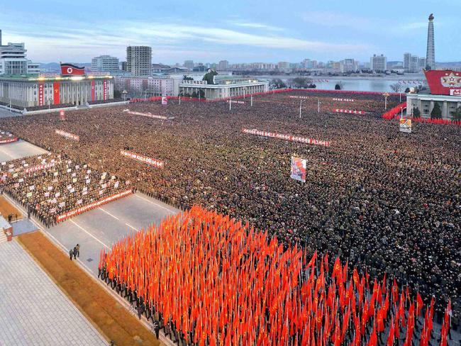 Thousands of North Koreans pictured in a huge show of support for Kim Jong-un who announced plans to test-fire a ballistic missile capable of reaching the US mainland. Picture: AFP