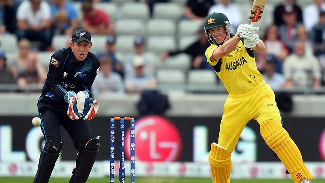 New Zealand wicket keeper Luke Ronchi (L) watches a shot from Australia's Adam Voges during the 2013 ICC Champions Trophy cricket match between Australia and New Zealand.