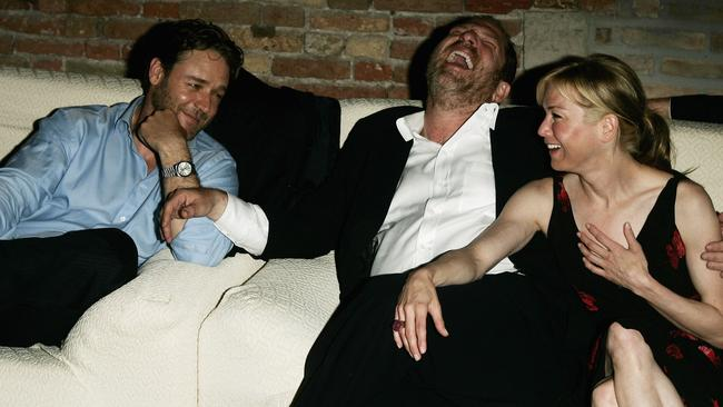 Actor Russell Crowe, producer Harvey Weinstein and actress Renée Zellweger attend the after-party for  <i>Cinderella Man </i>in 2005. Picture: Pascal Le Segretain