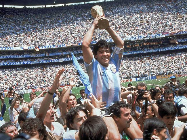 Argentina great Diego Maradona with the World Cup trophy on June 29, 1986.