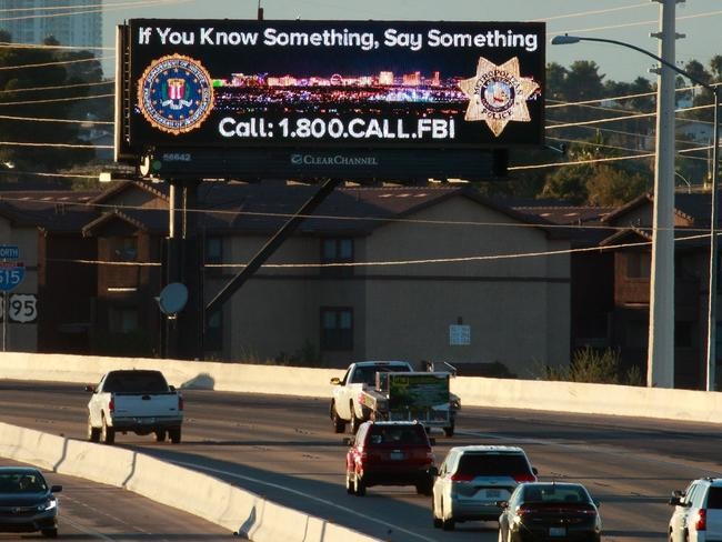 Vehicles drive past a billboard featuring a Federal Bureau of Investigation tip line phone number on Interstate 515, in Las Vegas, Nevada. Picture: Getty