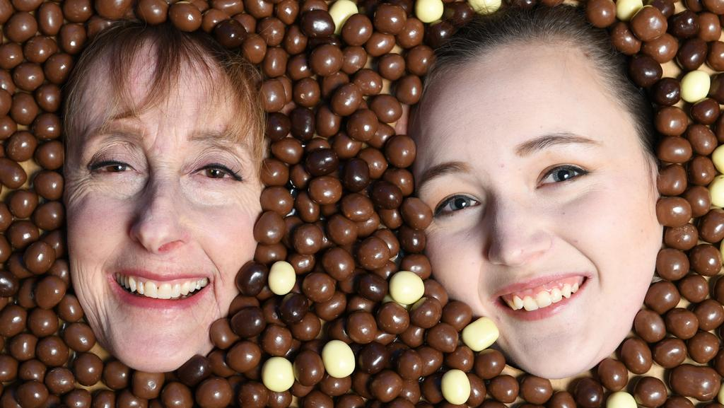 Oldest Robert Menz confectioner Nancy Carroll, 72, and its youngest employee Caitlin Searles, 19, covered in Fruchocs. Image AAP/Mark Brake