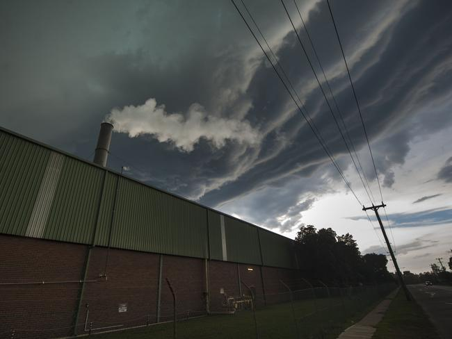 Rain rolls in over an industrial area in Rosehill.