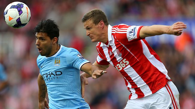Manchester City's Sergio Aguero vies with Stoke City's Robert Huth.