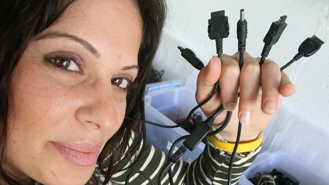 Loretta Cavallaro with her mess of mobile phone charger cables, all of which will soon be replaced by a universal charger.