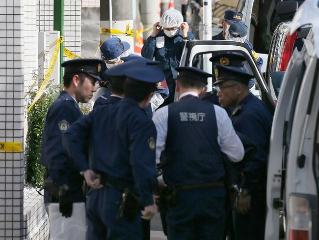 Police outside Shiraishi's flat where he says he killed them on the day he met them. Picture: AFP.
