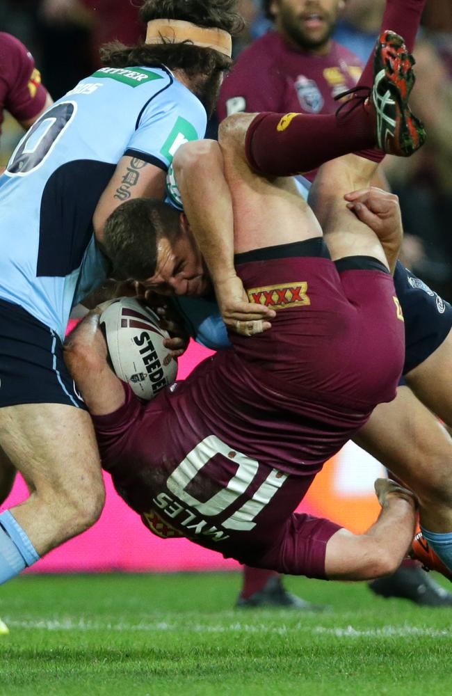 NSW forwards Greg Bird (right) and Aaron Woods drive Nate Myles into the turf.