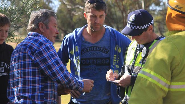 Pilot Geoff Hamilton talks to his family and police after his lucky escape.