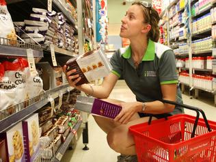 03/07/2009 NEWS: Kim Wade (27) with Woolies Select brand chocolate chip cookies in the Woolworth supermarket at Marsfield, Sydney, as more budget conscious shoppers go for the cheaper generic brands.