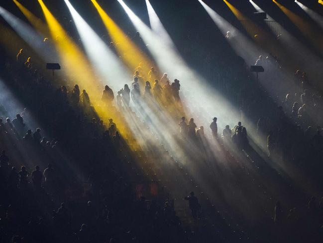 Spectators sit on the stands during a light show of the closing ceremony of the 2018 Gold Coast Commonwealth Games at the Carrara Stadium on the Gold Coast on April 15, 2018. Picture: AFP PHOTO / YE AUNG THU