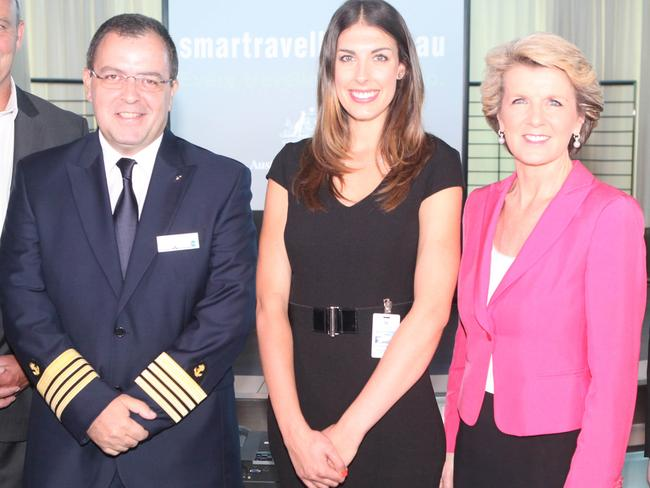 Captain Yannis Berdos with travel insurance advocate Natalie Hensby and Foreign Affairs Minister Julie Bishop at the 2013 launch of the Smartraveller advertising campaign. Picture: Jason McCormack