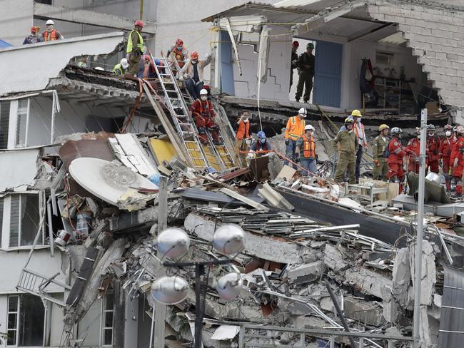 Specialists work at the site of a building felled by a 7.1-magnitude earthquake, in Mexico City. Picture: AP