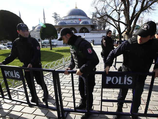 Containment ... policemen install security barriers at the historic Sultanahmet district, which is popular with tourists, after an explosion in Istanbul. Picture: AP