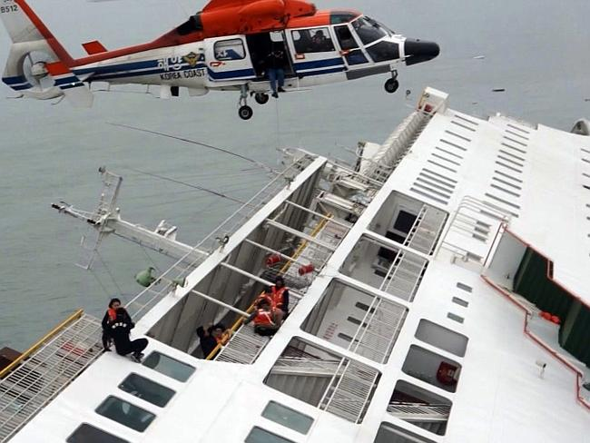 Lucky ones ... Passengers from the Sewol are rescued by a South Korean Coast Guard helicopter in the water off the southern coast near Jindo, south of Seoul.