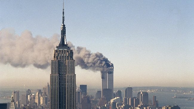The twin towers of the World Trade Center burn behind the Empire State Building in New York. The Sept. 11, 2001 terrorist attack is by far the most memorable moment shared by television viewers during the past 50 years, a study released on Wednesday, July 11, 2012, concluded. (AP Photo/Marty Lederhandler, File)
