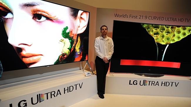 """LG unveiled a range of ultra high definition TVs including what it calls """"world's first 105-inch curved ..."""