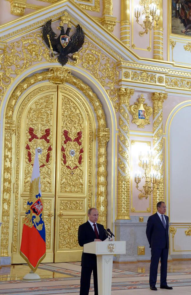 In case you didn't notice ... Russia's President Vladimir Putin speaks at a ceremony while accepting the credentials of the new foreign ambassadors at the Grand Kremlin Palace in Moscow.
