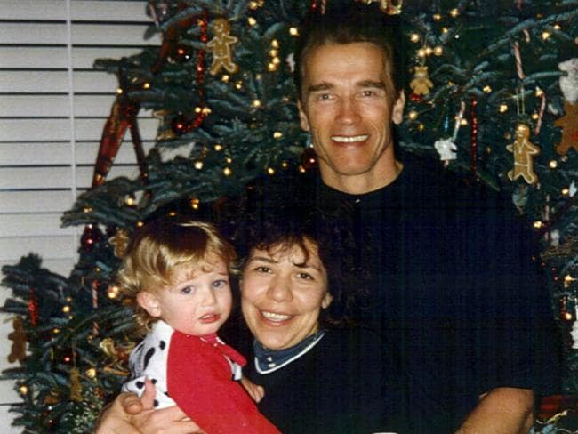 Arnold Schwarzenegger poses for a photo in 2000 with Mildred Baena, the mother of his alleged love child (who is seen holding Christopher Schwarzenegger, one of his sons with Maria Shriver).