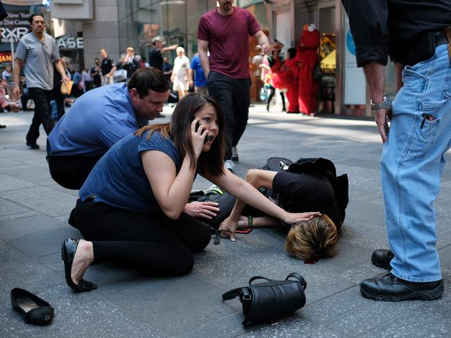 People tend to an injured man after a car plunged into him in Times Square in New York. Picture: AFP/Jewel Samad