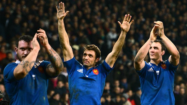 From left, France's loose head prop Thomas Domingo, star winger Vincent Clerc and No. 8 Louis Picamoles celebrate their side's victory over Argentina at the Lille-Grand-Stade in northern France. Picture: AFP