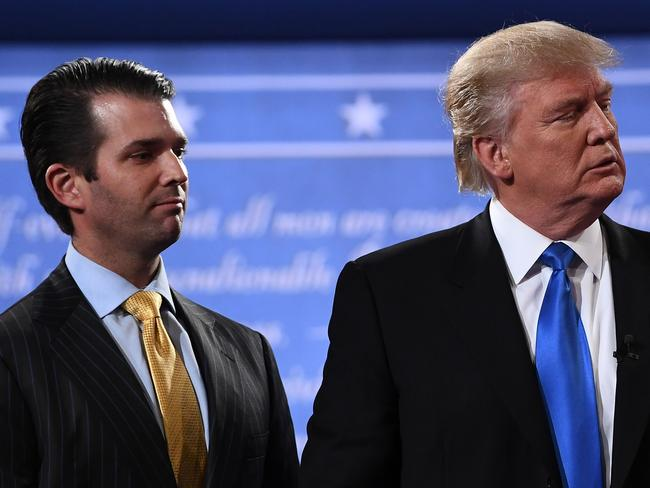 Donald Trump (R) standing with his son Donald Trump Jr. Picture: AFP