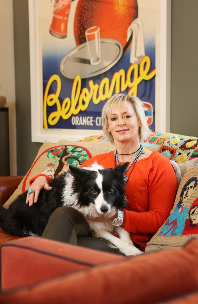At home ... Amanda Keller in her Sydney home with her sheep dog Minnie. Picture: Bob Barker.