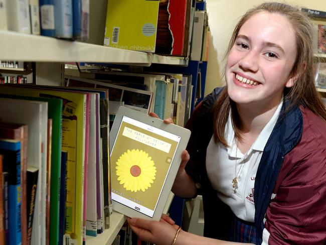 Future-proofing students ... A Melbourne high school student poses with an iPad to show that reading for literacy development and enjoyment can cut across platforms. Picture: Steve Tanner.