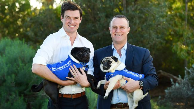 Tim Wilson, Liberal MP for Goldstein, right, with partner Ryan and pugs Ella and Louis. Picture: Josie Hayden