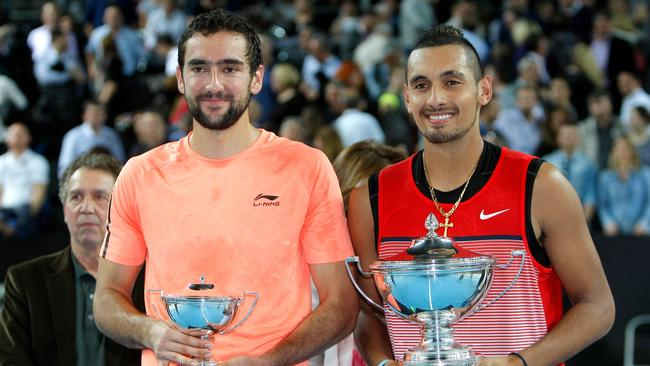 Marin Cilic of Croatia, left, and Nick Kyrgios of Australia hold their trophies. (AP Photo/Claude Paris)