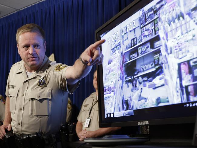 Final countdown ... Las Vegas Metropolitan Police Department Assistant Sheriff Kevin McMahill points to a surveillance video during a news conference yesterday.