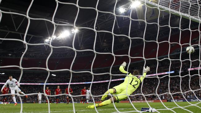 England captain Wayne Rooney finds the net with his penalty.