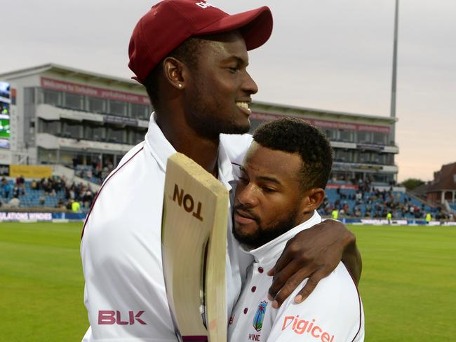 Shai Hope gets a hug from his captain Jason Holder after his heroics.