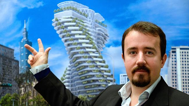 "Vincent Callebaut poses as he presents a picture of one of his futuristic projects on ""the city of tomorrow""."
