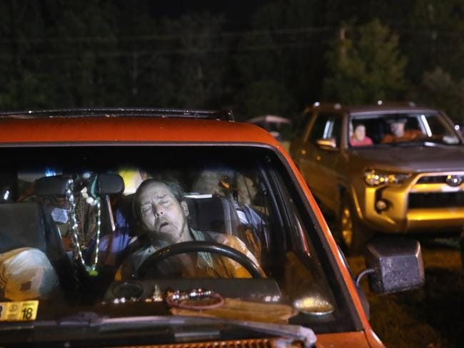 People sleep overnight in their cars to receive healthcare services at a free clinic on July 22, 2017 in Wise, Virginia. Picture: Getty.