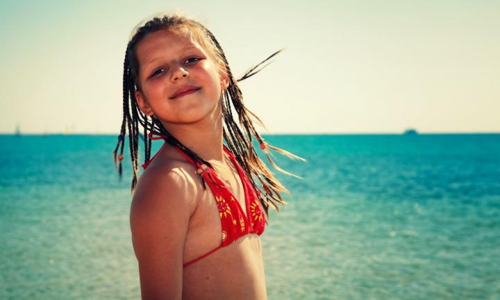 Portrait of the beautiful girl about the sea