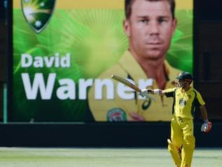 Australia's David Warner gestures after scoring 150 in the one-day international cricket match between Australia and Pakistan at the Adelaide Oval in Adelaide on January 26, 2017. / AFP PHOTO / Brenton Edwards / -- IMAGE RESTRICTED TO EDITORIAL USE - STRICTLY NO COMMERCIAL USE --