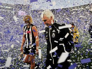 2011 Grand Final. Geelong v Collingwood. MCG. Dale Thomas and Mick Malthouse walks past Geelong as they celebrate.